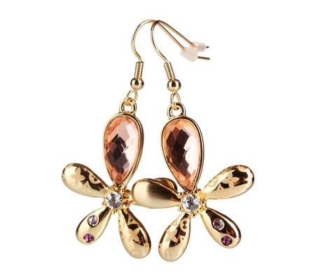 Earrings in the form of a flower with a yellow stone isolated on white