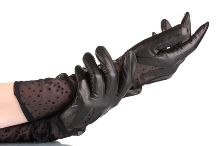 women's hands in black leather gloves isolated on white
