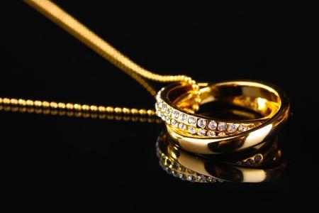 Photo pour Pendant in form of rings with gem on black - image libre de droit