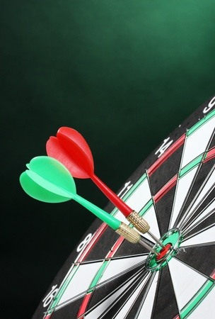 dart board with darts on green background