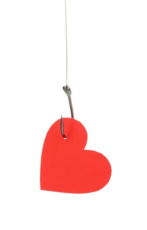 Heart on fish hook isolated on white