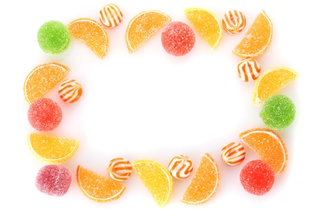frame of colorful jelly candies isolated on white