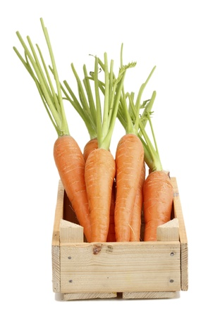 Carrots in crate isolated on whiteの写真素材