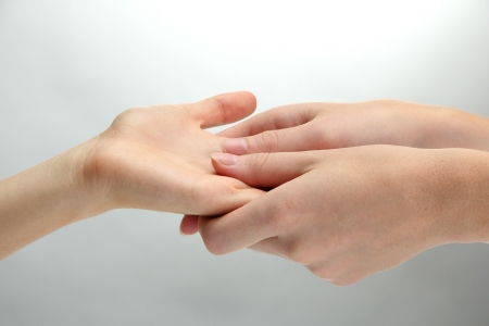 Hand massage, on grey background