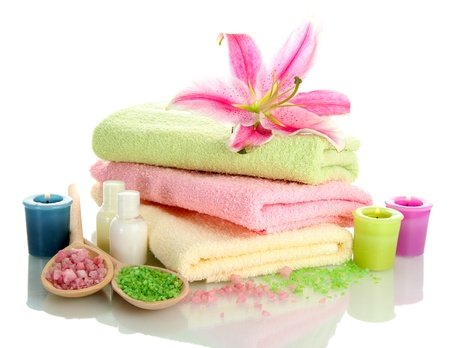 towels with lily, aroma oil,  candles and sea salt isolated on white
