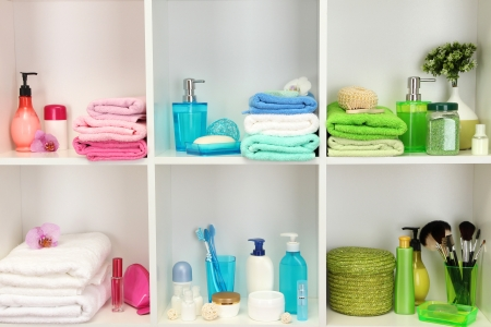 Bath accessories on shelfs in bathroom