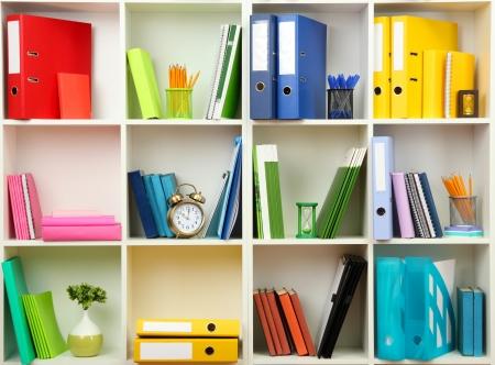 Foto de White office shelves with different stationery, close up - Imagen libre de derechos
