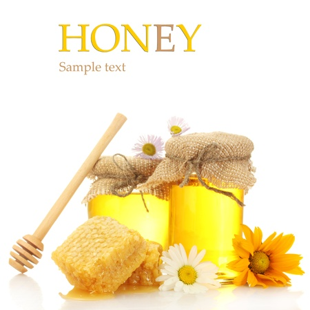 Jars of honey and honeycombs isolated on whiteの写真素材