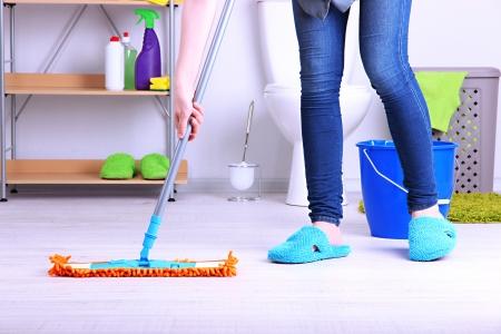 Photo pour Cleaning floor in room close-up - image libre de droit