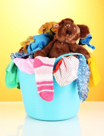 Blue laundry basket on orange background
