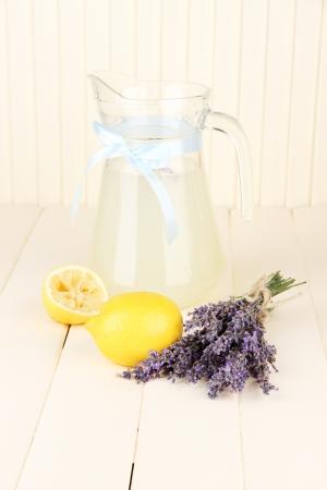 Lavender lemonade, on white wooden background