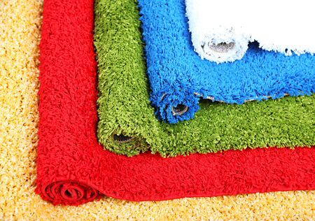 Many carpets of different colors close-up