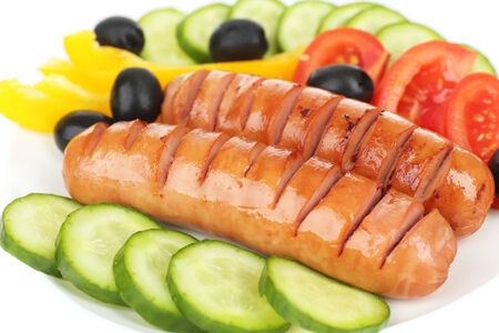 Grilled sausages with vegetables close up