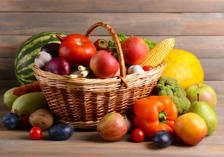 Photo pour Fresh organic fruits and vegetables on wooden background - image libre de droit