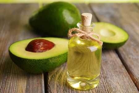 Photo for Avocado oil on table close-up - Royalty Free Image