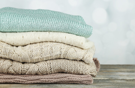 Photo pour Knitting clothes on light background - image libre de droit