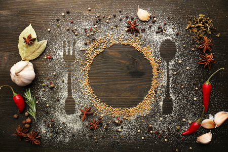 Photo pour Spices on table with cutlery silhouette, close-up - image libre de droit