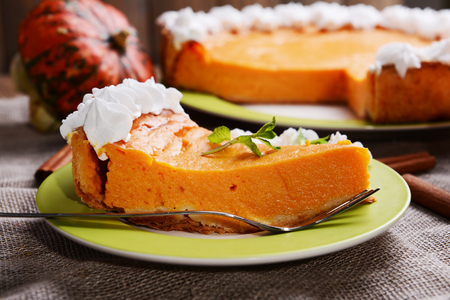 Photo for Piece of homemade pumpkin pie on plate on sackcloth background - Royalty Free Image