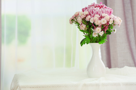 Photo pour Beautiful flowers in vase with light from window - image libre de droit