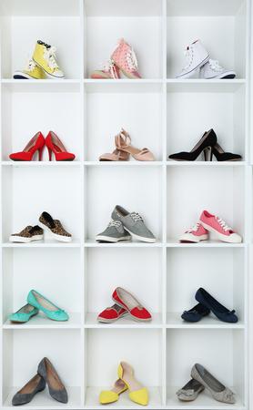 Photo pour Collection of shoes on shelves - image libre de droit