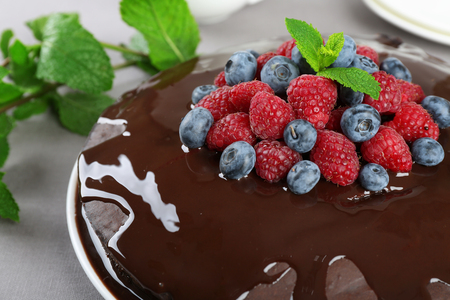 Delicious chocolate cake with summer berries, closeup