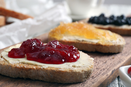 Foto de Fresh toast with butter and different jams on table close up - Imagen libre de derechos