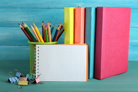 Photo pour School equipment on wooden background - image libre de droit