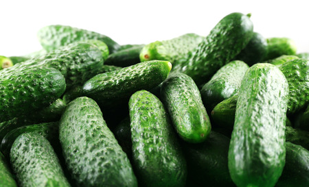 Ripe cucumbers on light background closeup