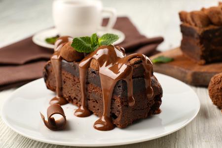 Photo pour A piece of chocolate cake with mint on the table, close-up - image libre de droit
