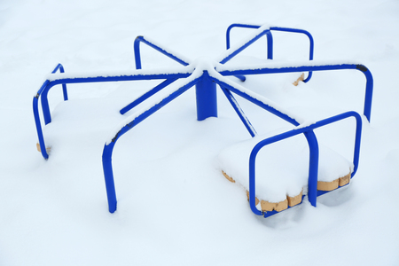 Empty merry-go-round in winter day