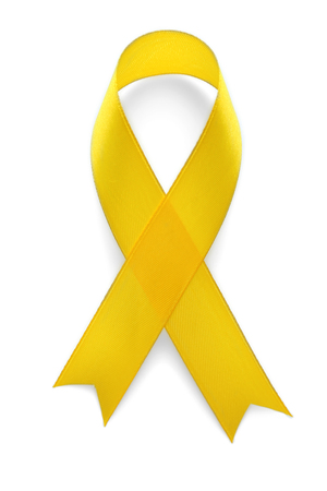 Photo for Yellow awareness ribbon on light background - Royalty Free Image