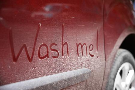 Photo pour Written text WASH ME on dirty car - image libre de droit