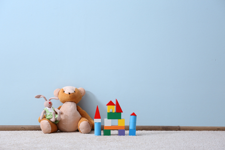 Foto de Different toys on blue wall background - Imagen libre de derechos