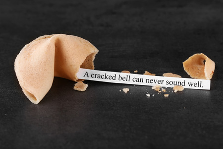 Fortune cookie on color background