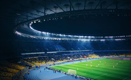 Photo pour Panoramic view of modern stadium during football match - image libre de droit