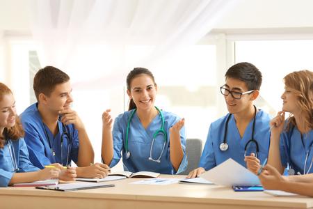 Photo pour Group of medical students having lecture indoors - image libre de droit