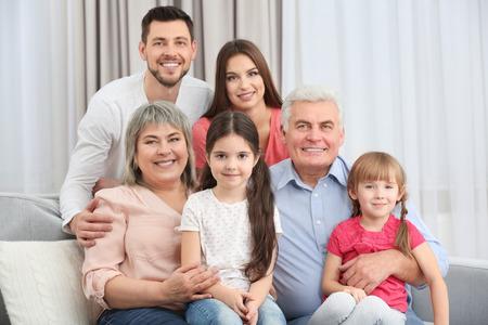 Foto de Happy family sitting on sofa in the room - Imagen libre de derechos