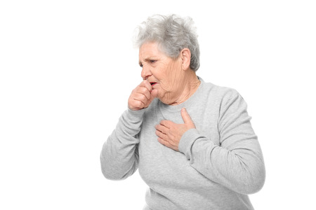 Photo pour Portrait of coughing elderly woman on white background - image libre de droit