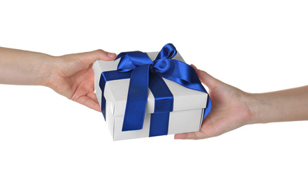 Foto de Hands giving and receiving gift box on white background - Imagen libre de derechos