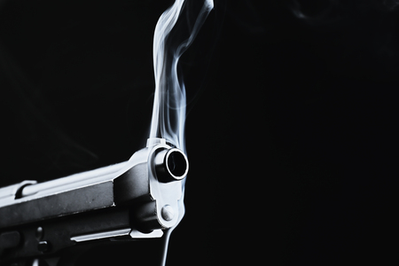 Smoking gun on black background