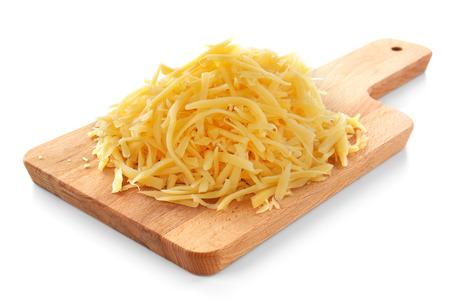 Foto de Wooden board with grated cheese on white background - Imagen libre de derechos