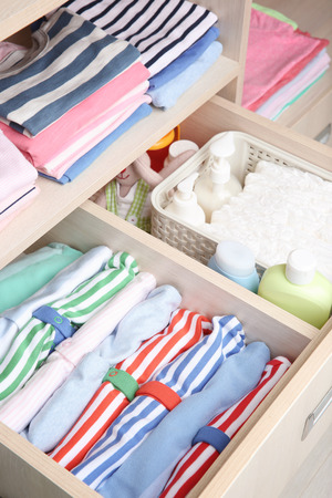 Photo pour Wardrobe with clothes and necessities in baby room - image libre de droit