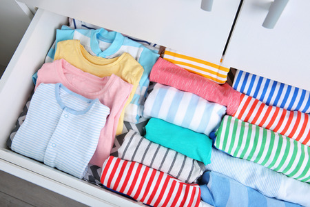 Photo pour Chest of drawers with clothes in baby room - image libre de droit
