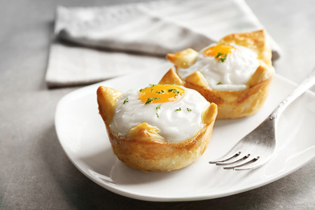 Foto de Tasty baked eggs in dough on plate - Imagen libre de derechos