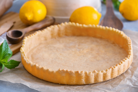 Empty pie crust on table, closeup