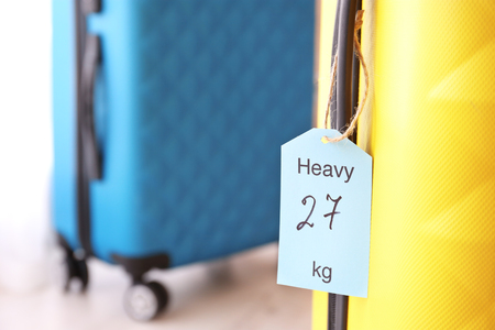 Photo pour Tag on heavy suitcase. Luggage overweight concept - image libre de droit
