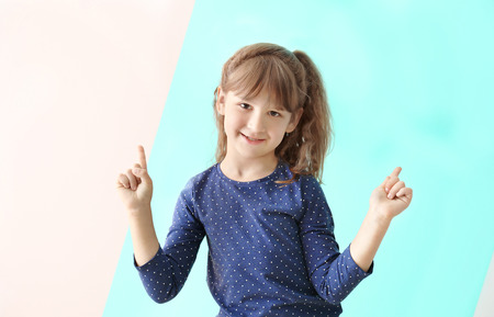 Photo for Cute funny girl on color background - Royalty Free Image