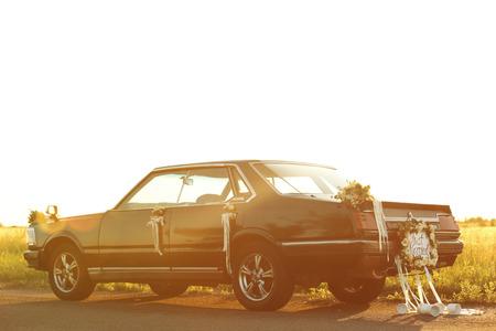 Foto de Beautiful wedding car with plate JUST MARRIED and cans outdoors - Imagen libre de derechos