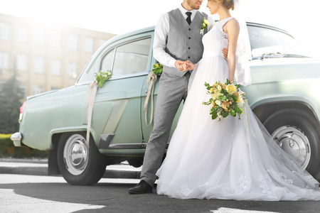 Foto de Happy wedding couple near decorated car outdoors - Imagen libre de derechos