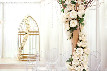 Foto de Tree decorated with beautiful flowers in wedding hall - Imagen libre de derechos